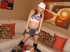 Ann Angel looks sexy in her pimp hat and short jean skirt
