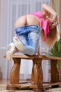 With a naughty smile lighting up her pretty face, Mila slowly strips her pink shirt and rugged denim pants as she pours a glass of water on her to highlight her gorgeous body on the center table.
