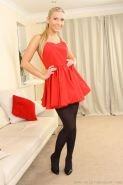 Michelle wearing gorgeous evening dress with black stockings and lace thong.