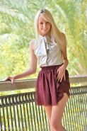 Blonde teen Sierra lifts her dress and shoves a golf ball up her pussy