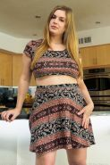 Busty hottie Danielle shows you what's up her skirt in the kitchen