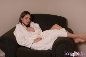 Pictures of teen beauty Lana Brooke getting topless on the couch