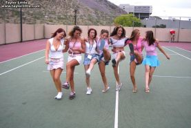Teen girls get a little wild on a tennis court