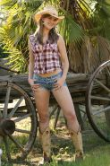 Cute brunette country girl does a sexy strip tease on the farm