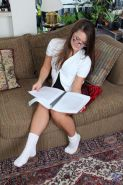 Horny Nubile Penny loves to read books while spreading her adorable pussy with her fingers