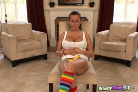 Busty brunette Brandy Talore masturbates with her banana