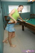 Lana plays a game of naked pool