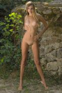 Blonde teen Enko shows off her tight nude body in a forest