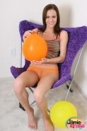 Horny babe Jamie Ryans teases with her almost sheer panties while playing with balloons