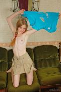 Redhead teen Avril A shows off her tight nude body on the couch