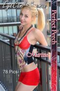 Petite blonde teen Marissa strips naked on a balcony over-looking the city