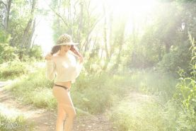 Lily Xo strips and teases in her thong on safari