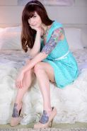 Ivy Snow reveals her perfect body as she takes off her teal dress and peach panties