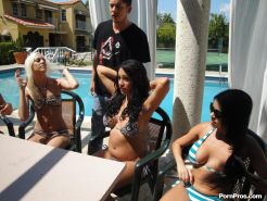 Crazy party coeds give a lucky dude a reverse gang bang by the pool