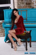 Beautiful brunette Ann Denise teasing at the old piano
