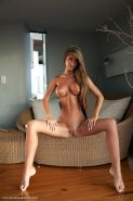 Nessa Devil gets completely naked and spreads out for you in the living room