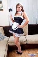 Cate Harrington strips out of her slutty little maid costume and masturbates with her black dildo