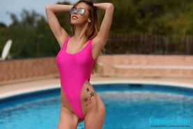Jennifer Ann strips from her pink swimsuit by the pool