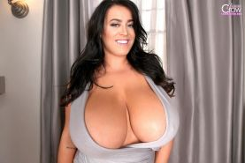 Busty brunette Leanne Crow drops her top to reveal her massive jugs