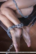 """Short-haired girl Lindra chains herself up in """"Unleashed"""""""