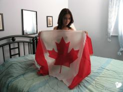 Pictures of Cassie Leanne rolling around in a canadian flag