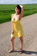 Pictures of Bryci exposing her tits on the country road