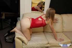 Blonde teen Mandy Roe teases in her red thong on the couch