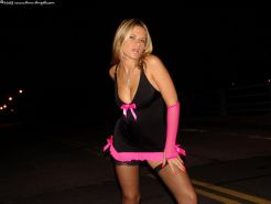 Pictures of Ann Angel dressed in sexy black and pink lingerie outside