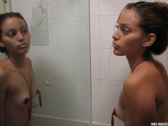 Latin girl Elina puts on some pasties and teases in front of the mirror