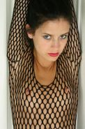 Pictures of teen Solo Sydney ripping open her fishnet body suit