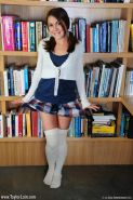 Pictures of schoolgirl Taylor Lain getting naughty in the library