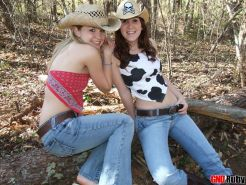 Hot teens Ruby and Shelby play cow girls outdoors in the forest exposing their perky tits