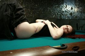 Pictures of Liz Vicious showing you her pussy on a pool table