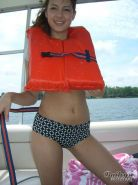 Pictures of teen cutie Bailey's Room exposing her boobs on a boat