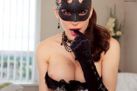 Katie Banks dresses in a mask and lingerie and invites you to play with her