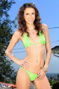 Belle Knox gives you a sexy solo striptease in her bikini