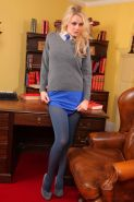 Blonde model Amber Leigh strips out of her short blue miniskirt and tight