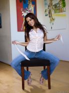 Pictures of Ann Marie Rios stripping out of her jeans