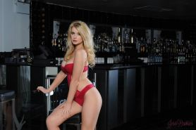 Blonde babe Jess Davies starts stripping for you at the bar