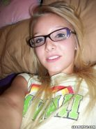 Gorgeous amateur blonde nerd in glasses takes hot pics of herself