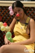 Brunette teen Eva gets naked and plays with balloons