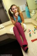 Super hot teen girl Kir gets naughty with a lollipop, pigtails and socks