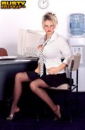 Busty blonde Kelly Kay shows you her huge tits in the office