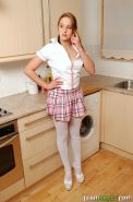Adorable brunette schoolgirl in stocking gets naked in the kitchen and toys her hairy pussy