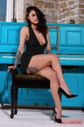 Mica Martinez strips out of her tight black dress at the piano