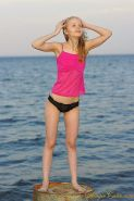 Pictures of teen girl Angie Cutie spreading on a beach