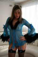 Pictures of Ann Angel dressed in sheer lingerie smoking a cigarette
