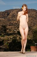Redhead girl Sensi Pears spreads her legs and shows you her pretty flower