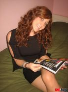 Super horny redhead teen Ruby rubs her wet pussy while looking at a porn mag