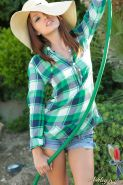 Hot country girl Ashley Doll gets all wet in the garden